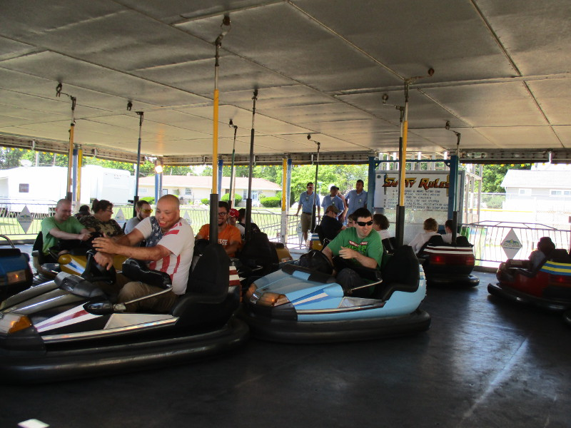 Adults enjoying some bumper cars